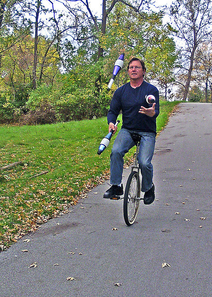 Visitor from Cleveland to the Rochester region is getting his workout on the canal path trail today 10/10/12.  This look s extremely hard to do. ride a unicycle, juggle and not look at the road or wear a helmet.!!!!!!