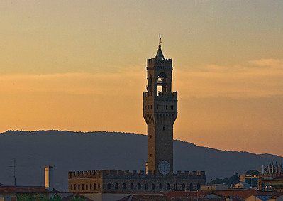 The tower of the Palazzo Vecchio next to the Uffizi at sunrise in Florence, Italy.