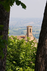 A church viewed from the western side of San Gimignano.