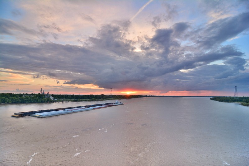 """Sunset as a boat from Ingram Barge Co pushes a large load down the mighty Mississippi River - near Greenville, MS - feel free to share!<br /> <br /> See more at  <a href=""""http://www.instagram.com/johnmontfort"""">http://www.instagram.com/johnmontfort</a>"""