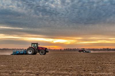Sunset on Smythe & Sons - Tribbett, Mississippi - You've got to love American-colored equipment!