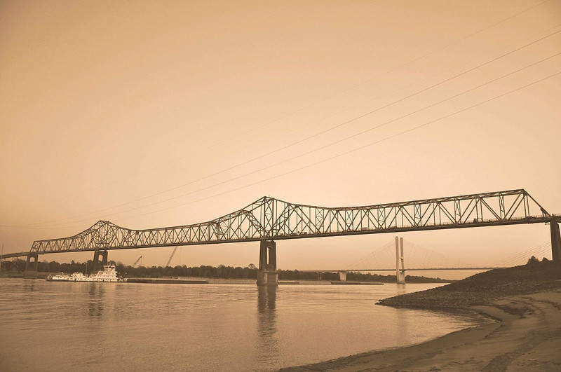 Old Mississippi River bridge and Barge - Greenville, MS