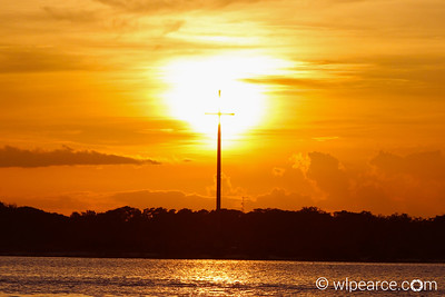 The St. Augustine cross backlit by the setting sun. Get notifications via: