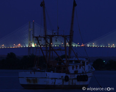 Shrimp boat at late dusk.  Dames Point Bridge in background.