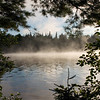 Morning mist at sunrise on Lake Umbagog in New Hampshire