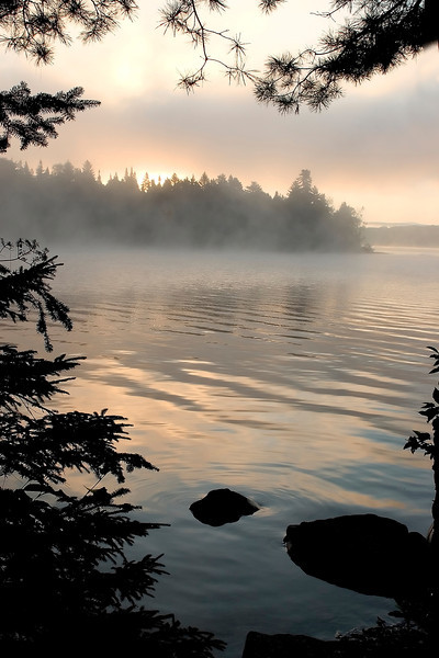 Sun rises on remote Lake Umbagog in New Hampshire