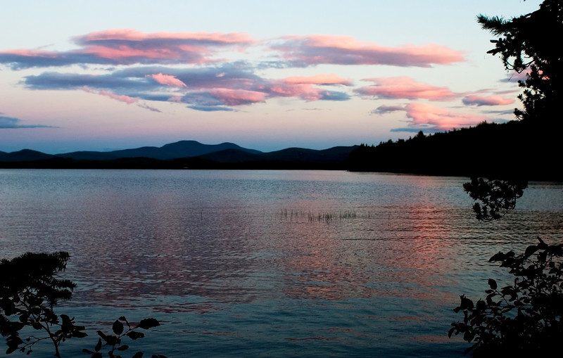 Pink clouds reflected in Lake Umbagog in New Hampshire