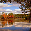 Clouds reflected in Harvard Pond on a bright Fall day