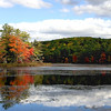 Harvard Pond in Massachusetts boasts colorful Fall trees reflected in quiet water