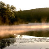 Morning mist at sunrise on Harvard Pond New England