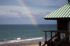 The Rainbow Ends at Life Guard Station #9 at Ref Reef Beach, Boca Raton, Florida....hmm wonder if it points to  a pot of gold beneath the sea or bits of lost Spanish galleon coins? Who is to argue with a sign...where's my mask?