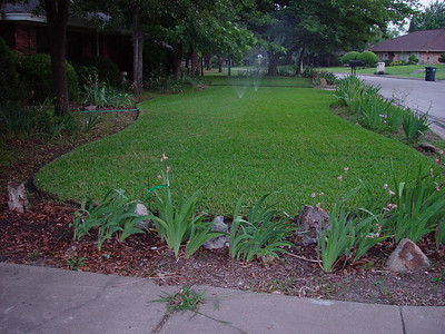 Photo taken May 2008 - Well watered landscape. West side of residence. Refer to BCI photo, Elevation 2.