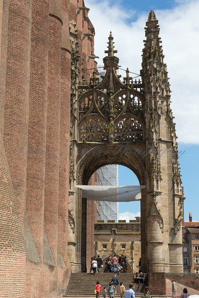 Albi Cathedral entrance on a warm summers day with tourists and pilgrims ascending the steps