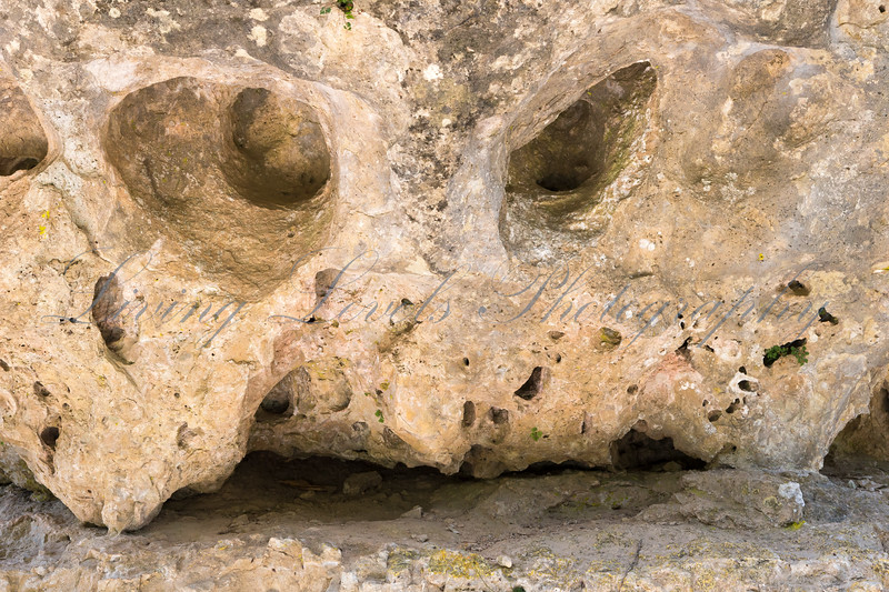 An eroded limestone formation resembling a face with eyes at the Parc de Loisirs Nature de Montpelier-le-Vieux near Millau.