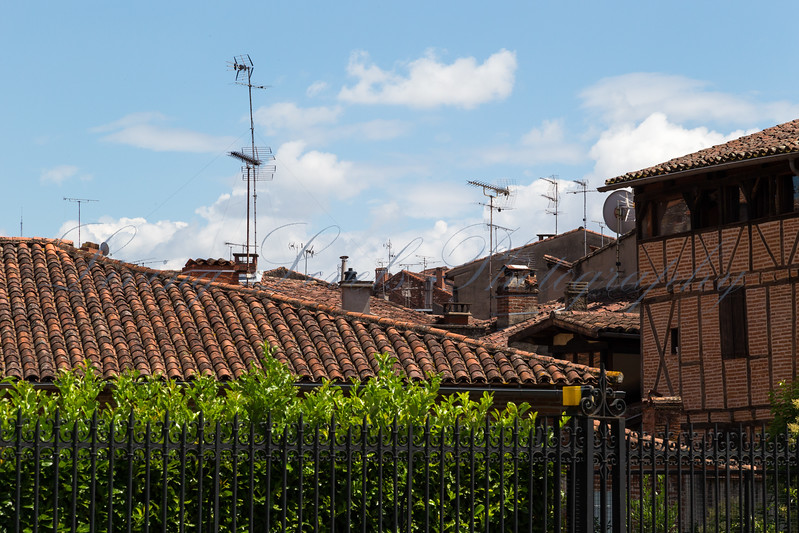 Ariel Photography - Medieval timber framed buildings jostle for position with ariels and satellite dishes in Albi, France