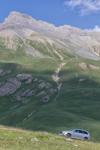 A Volvo XC90 parks off-road allowing tourists to walk in the stunning Col de Larche,