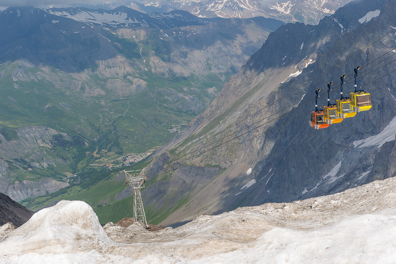 Cable cars descending the Col des Ruillans, La Grave, French Alps in July