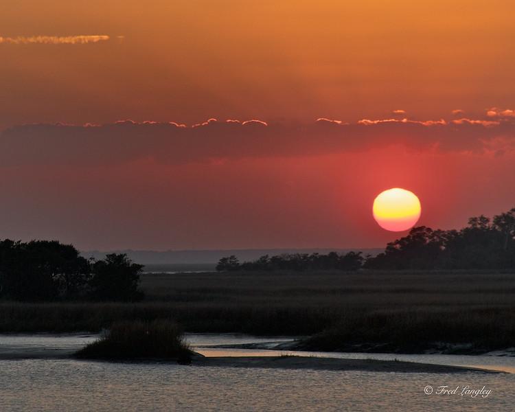 Sundown. <br /> The December sun slowly sets over Green Island.