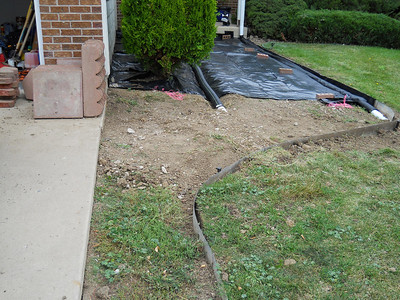 Day #3 - Bury ends of drains, compact soil, start plastic