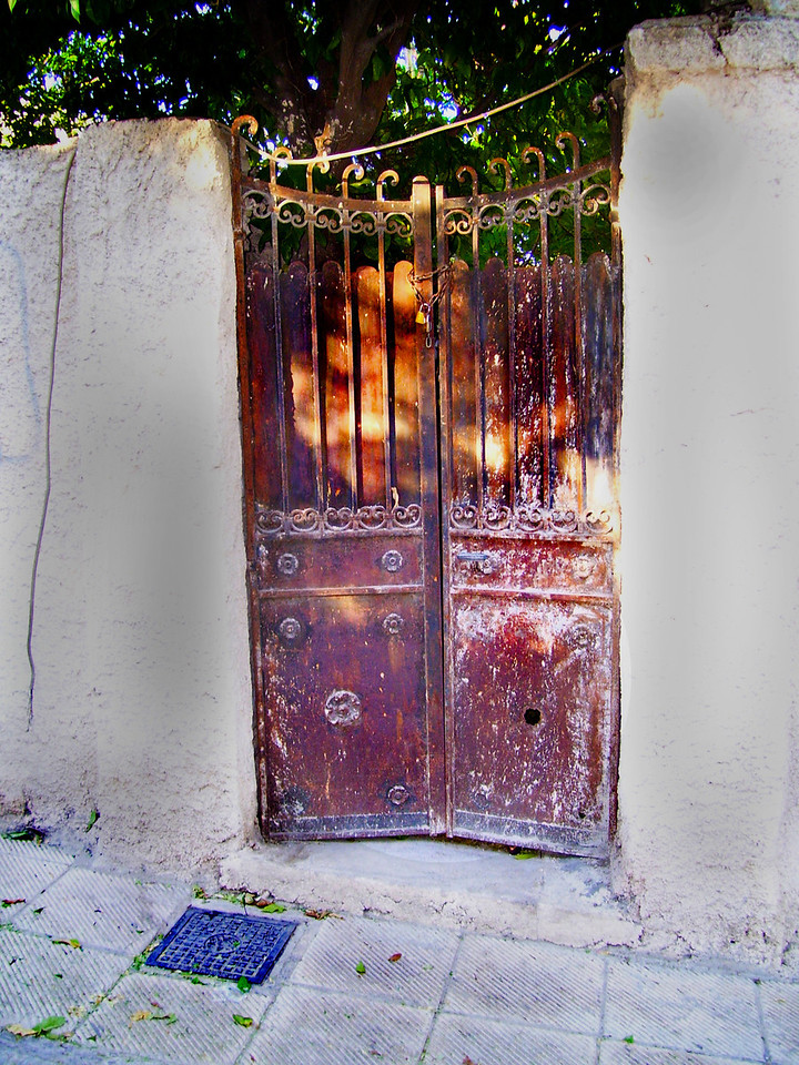 Old rusted gate that looks like it could lead to a secret garden.  Streets of Athens, Plaka.