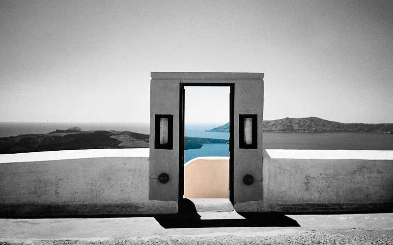 Walking through the town of Thira on Santorini I came upon a doorway that seemed to lead to nowhere.  Looking through the portico, the view was magical.  I decided to try to capture that feeling.
