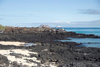 Galapagos Trip - Galapagos, Bachas Beach, Santa Cruz Island<br /> Bachas Beach shoreline with Celebrity Xpedition in background