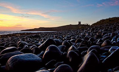 Sunrise boulders at Dunstanburgh