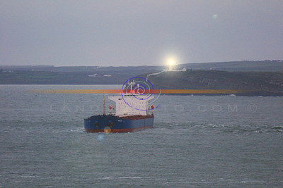 "A Ironic Blas of Light from the Lighthouse accroc the river shannon from Beale as the Cargo Ship teh ""Princess"" runs a ground on a sand bank. Pic Brendan Landy"