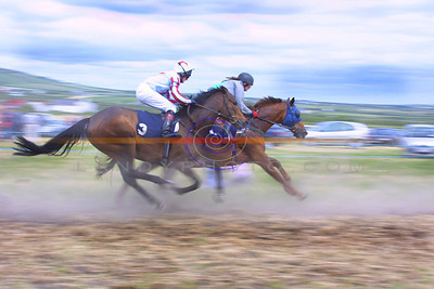 Rising dust in one of the races as the horses pass the post at annual Ballybunion races. Pic Brendan Landy