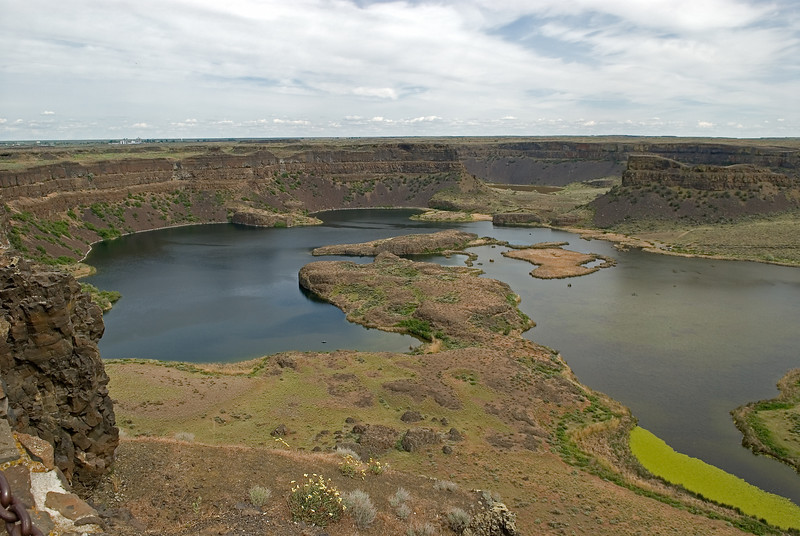 Dry Falls of the Columbia.  Over 10,000 years ago, a 300 foot wall of water cascaded over this 400 foot high basalt precipice and created the largest waterfall this world has ever known.