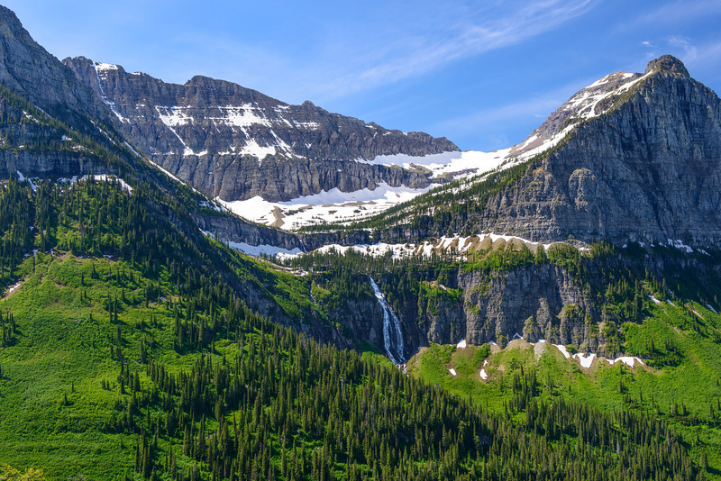 """""""Bird Woman Falls"""" Going to the Sun Road, Glacier National Park. Just back from a week in Glacier National Park with the family! What an incredible place. Our first time there. We did the Red Bus tour and had perfect weather and skies. More posts coming later!"""
