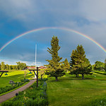 """Rainbow in Glacier National Park"" After a nice rain up in Glacier National Park, this double rainbow popped out at the Glacier Park Lodge over the train station. The grounds at the Glacier Park lodge with walkways and flowers are great to stroll around! I am ready to go back. Enjoy!"