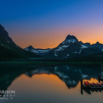 """Sunset from the Many Glacier Lodge"" Glacier National Park, Swiftcurrent Lake. Many Glacier Hotel From this summer with the calm lake and the reflections on the lake. Those canoes couldn't have been put in a better spot! Just sipping a cocktail and enjoying the view - it was stormy and whitecaps on the lake the previous evening! — at Glacier National Park."