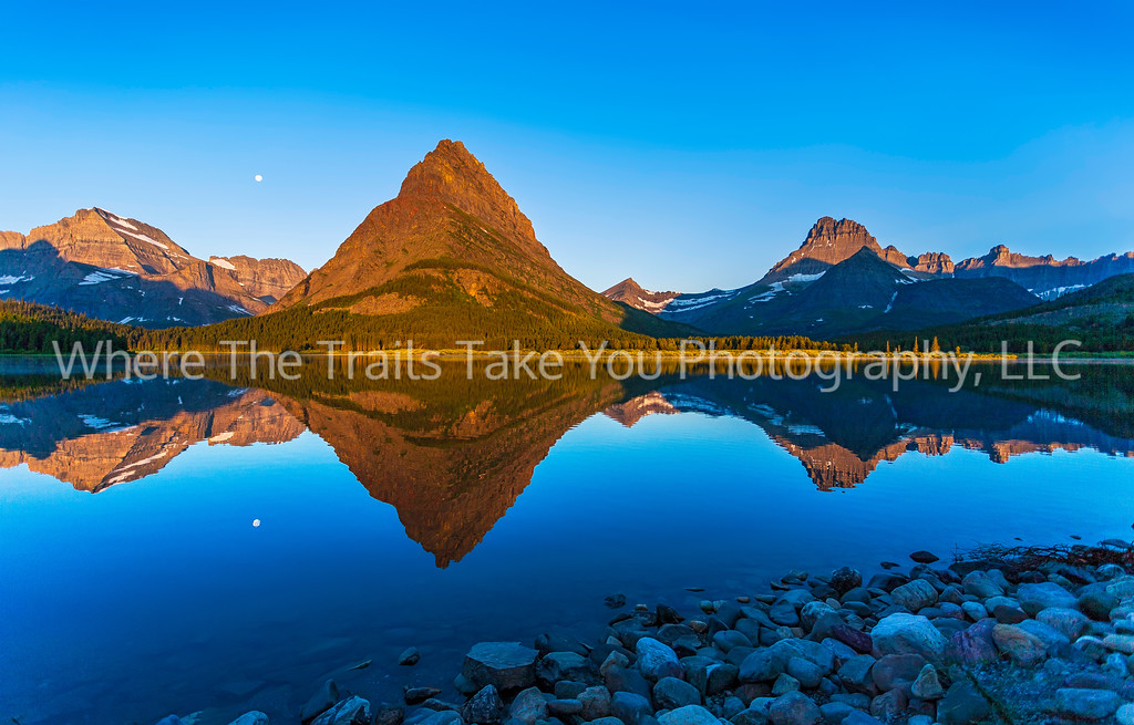 68  Sunrise and Moonset Swiftcurrent Panorama in the Many Glacier Area of Glacier National Park, Montana, with Mts. Gould, Grinnell, and Wilbur.
