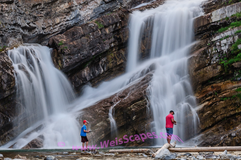 Fishing by Cameron Falls, Glacier International Peace Park, Waterton Village, Alberta Canada.