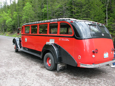 Vintage red buses used on the Red Bus Tours