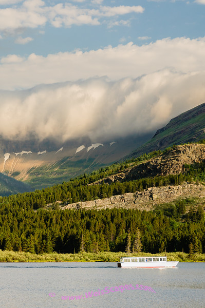 Clouds flowing over the mountaintops, Glacier National Park.