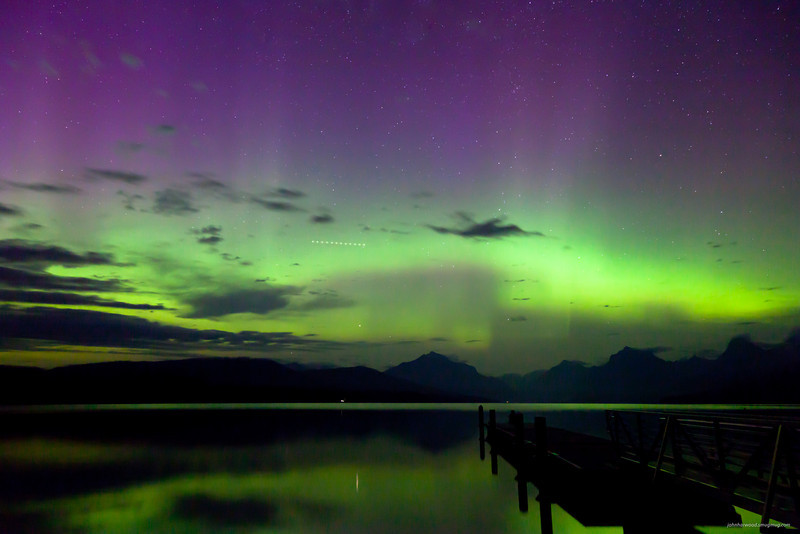 Northern Lights & Shooting Star above Lake Mc Donald in Glacier National Park. Glowing smoke haze to add to the splendor.