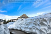 Snow at the Logan Pass Visitor center. Reynolds Mountain in the background.