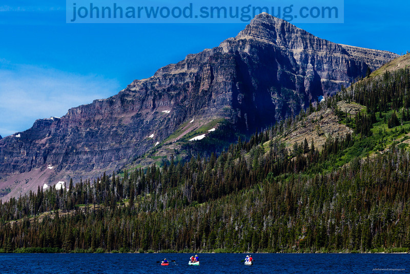 Paddlers on Two Medicine Lake in Glacier National Park