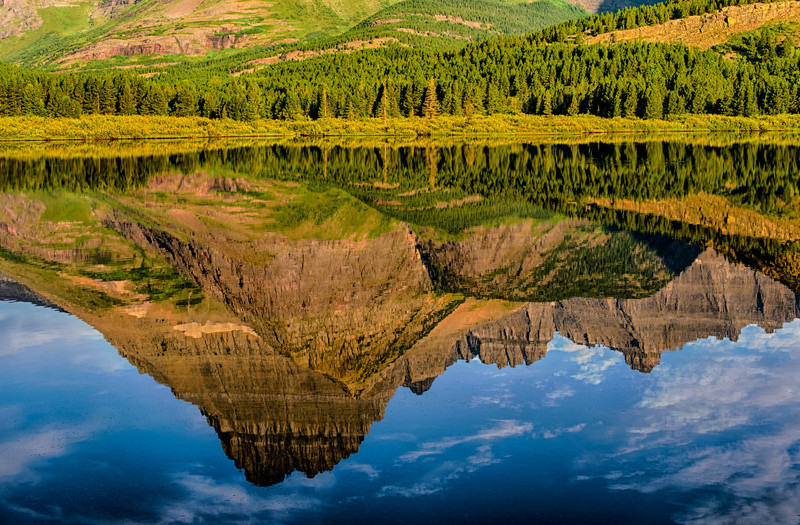 Reflection of Grinnell peak at Swiftcurrent lake<br /> Many Glacier