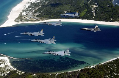 OVER FLORIDA -- A formation of 325th Fighter Wing F-15 Eagles and an F/A-22 Raptor fly above Panama City, Fla.  The Raptor will eventually replace the F-15 Eagle in the Air Force inventory.  (U.S. Air Force photo by Master Sgt. Mike Ammons)
