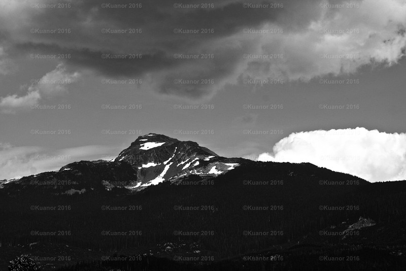 Mirrored Peak<br /> A grey and black peak has a mimic in the clouds above. Serendipitous.