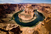 A River Runs Through It<br /> <br /> Giant river rafts make their way down the Colorado River around Horseshoe Bend in the upper portions of the Grand Canyon<br /> Horseshoe Bend, Page, Arizona