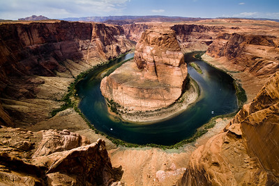 A River Runs Through It  Giant river rafts make their way down the Colorado River around Horseshoe Bend in the upper portions of the Grand Canyon Horseshoe Bend, Page, Arizona