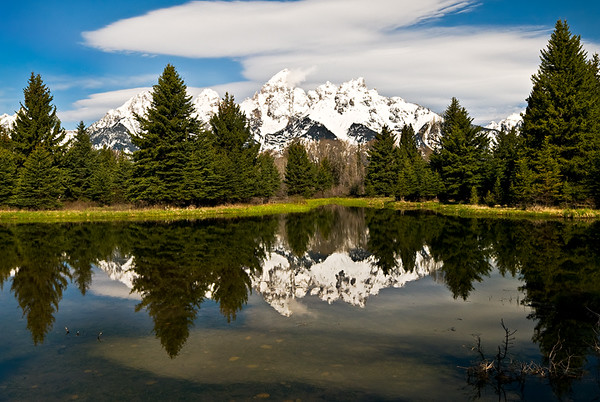 Schwabackers Landing.  The clouds were moving over as I shot this nice view of the Grand Tetons.  Such an amazing place.  The winds picked up just after I shot this and it never was as nice.  Glad I captured it when I did!
