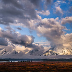 """""""Lightscapes in Grand Tetons National Park""""  The clouds and lighting were amazing when I was here in the Grand Teton National Park.  The sun would peak through on the mountains revealing the snow covered peaks.  This was at the end of May when the park was just awakening after a long winter.  I love the way the blue skies peak around the clouds letting the light through.  We didn't see the Grand Tetons much during the 5 days I was there!  Yet another amazing National Park that we have."""