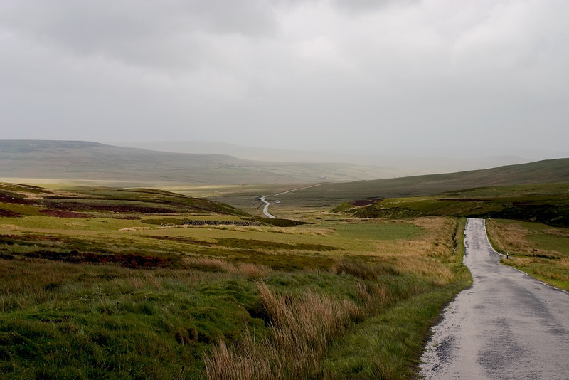 Country road winding through the Yorkshire Moors, England
