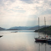 Scottish Loch in evening light with sail boats sitting quietly