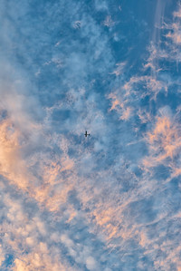 20120822.  Sunset clouds and small airplane above Great Meadows NWR.